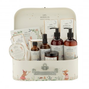 Woodland Friends open suitcase with Konjac Sponge, Sleep Time Tales Book, Sleep Time Bath & Massage Oil, Sleep Time Pillow Mist, 240ml Sleep Time Top to Toe Wash, 240ml Sleep Time Top to Toe Cream, Comfort & Calm Rescue Cream